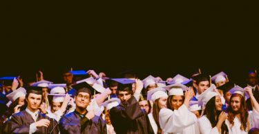 graduating students in black and white clothes