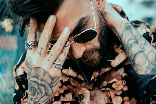 man with beard glasses and tattoos