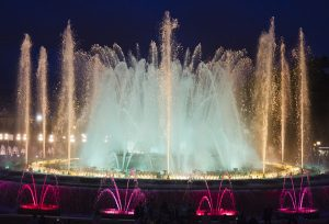 red, white and green colours at magic fountain barcelona