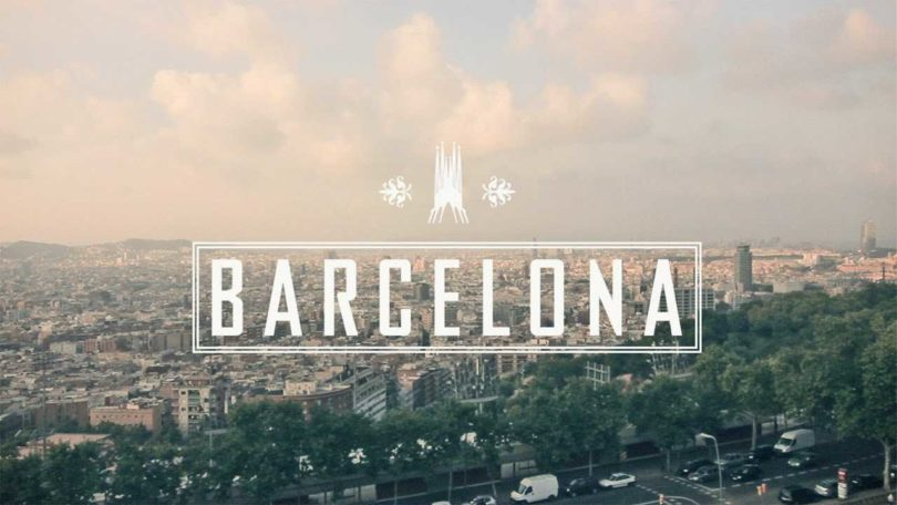 word barcelona with view of the city in background