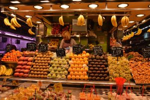 stall plenty of fruit hanging from the ceiling