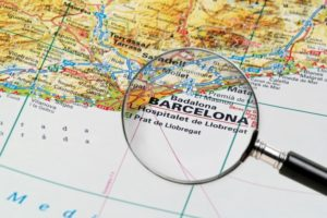 map and magnifying glass over barcelona