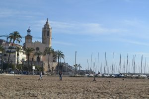 beach in sitges with church