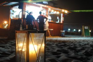evening at beach bar with lantern