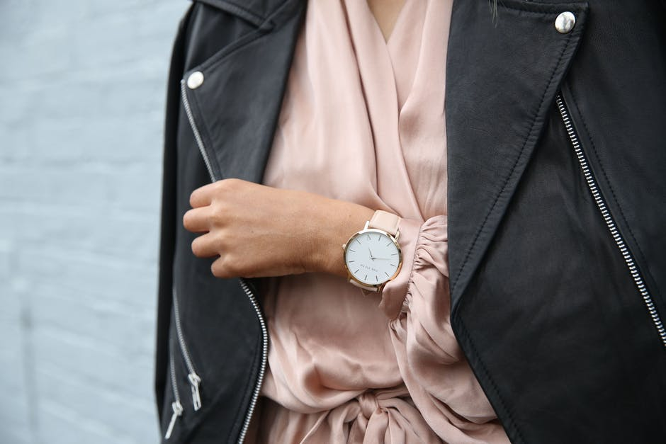 watch and pink dress with black jacket