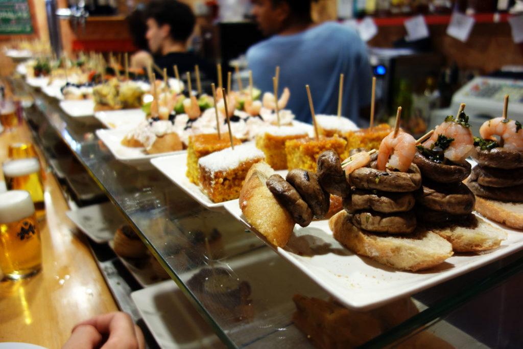 plates of pintxos and tapas along the bar