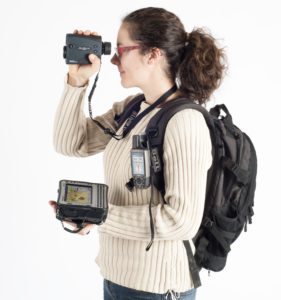 lady with camera, navigation and rucksackk