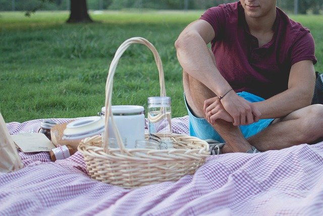 man with picnic basket in park