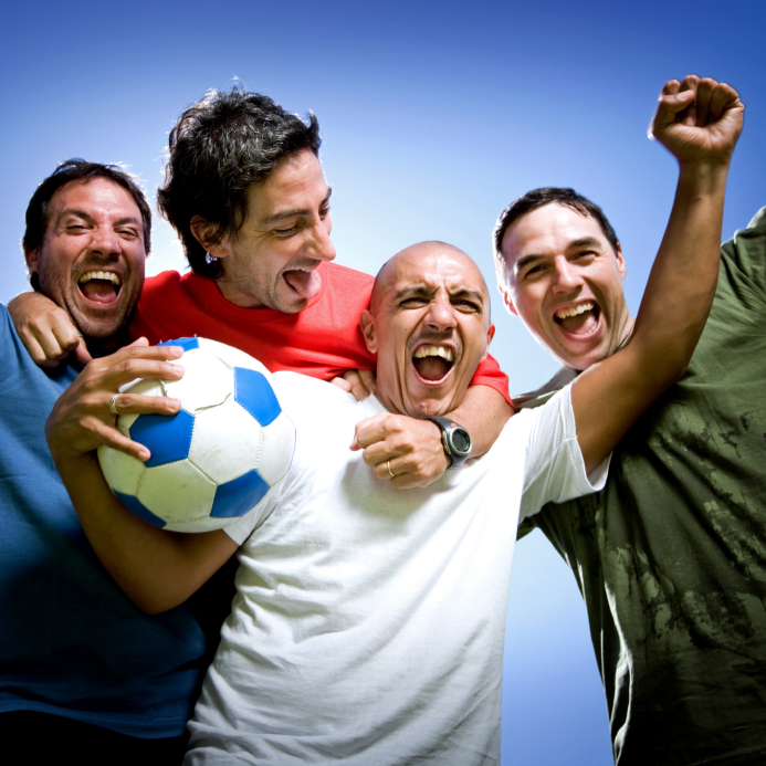 four happy men with football