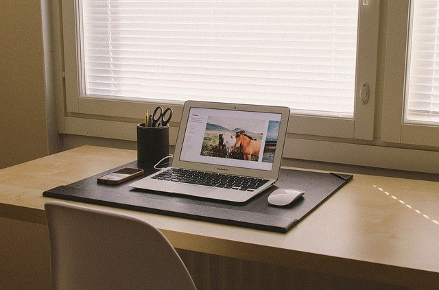 student desk with laptop