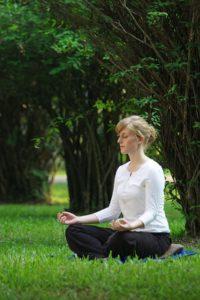 lady meditating outdoors