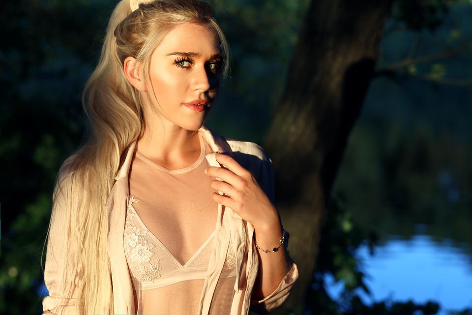 blond lady in see-through bra