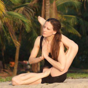 lady doing yoga on beach