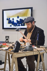 artist at work at his desk