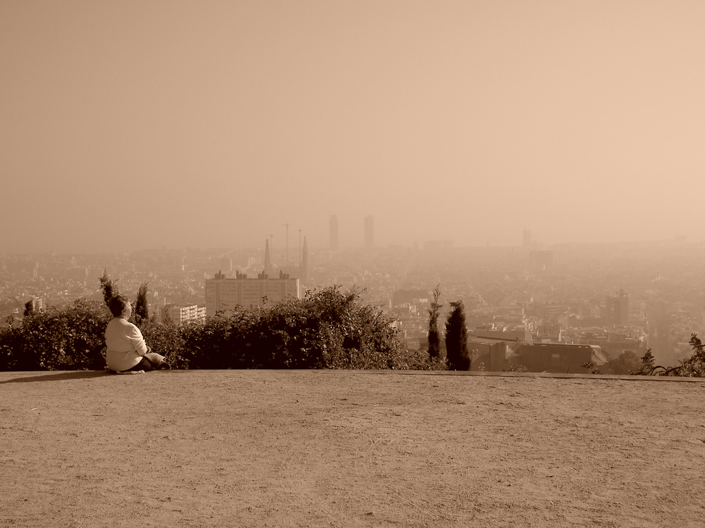 sitting and watching misty skyline barcelona