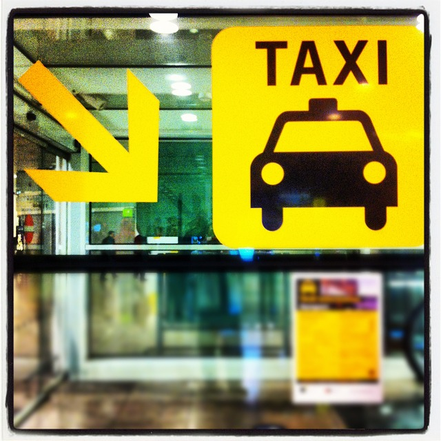 taxi sign on window