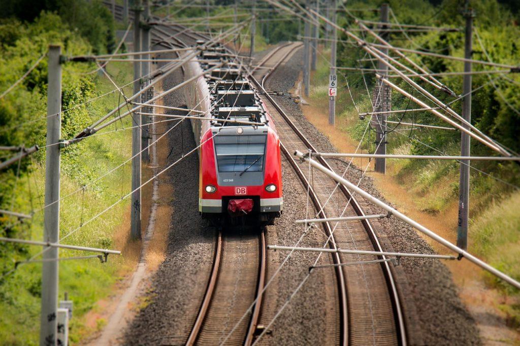 train in green landscape