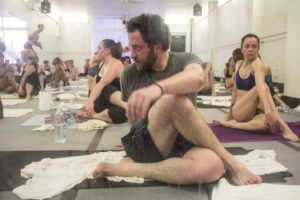 group of people doing yoga inside a hot room