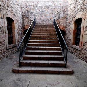 interior montjuic castle,, large stone stairs