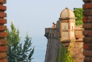 castle of montjuic with the sea behind it