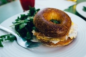 bagel with fork on white plate