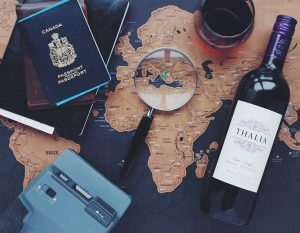 Wine, magnifying glass and passport