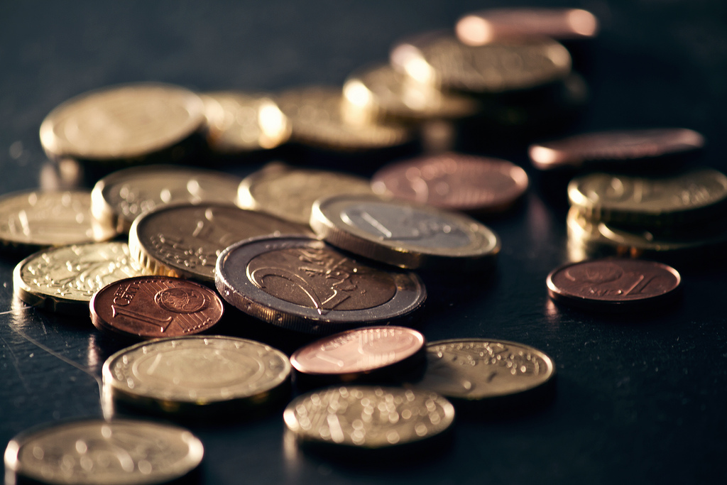 Coins on a black table