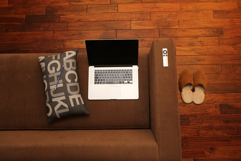 brown couch with laptop