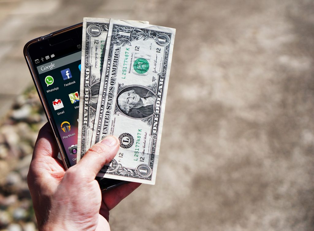 phone with apps and cash