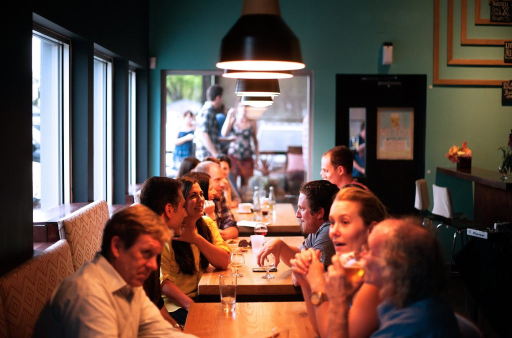 people in restaurant having conversation