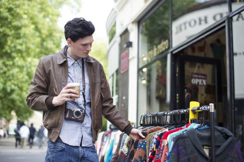 man shopping in street
