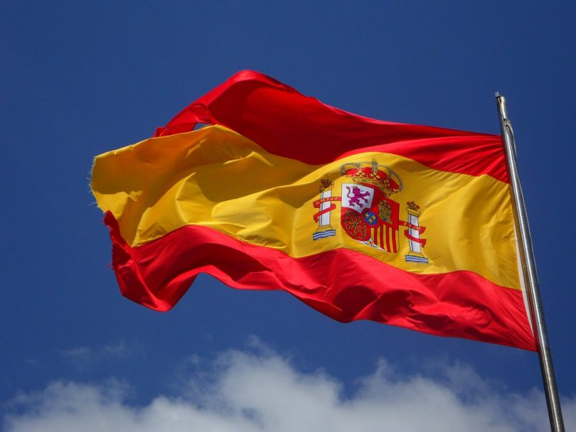 spanish flag with blue skies