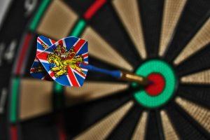 dart hits bulls eye on dart board