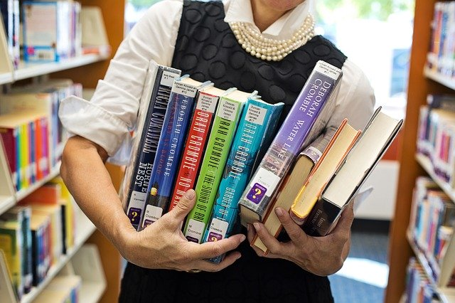 librarian with books