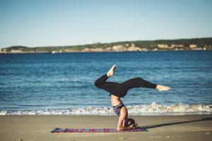 woman on beach doing pilates exercise