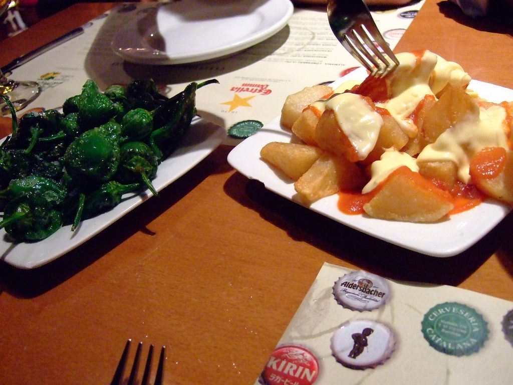 patatas bravas and green peppers