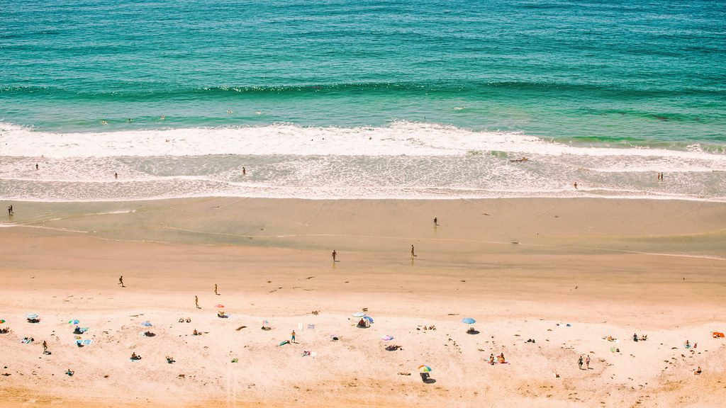 wide beach with beach goers