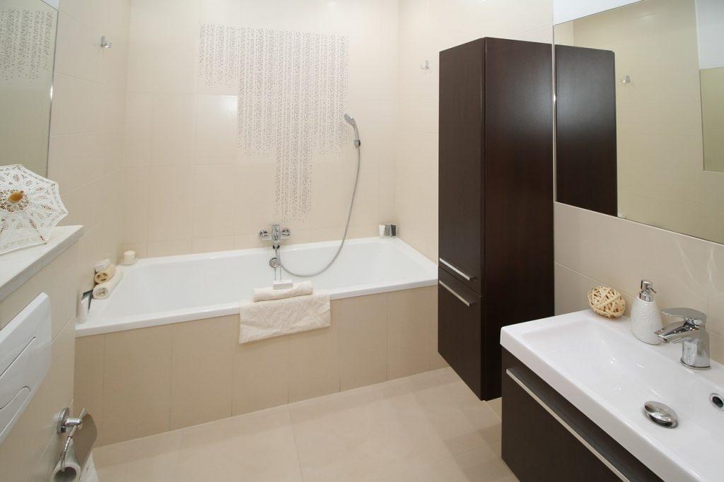 light bathroom with bath