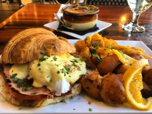 eggs benedict on croissant with roast potatoes