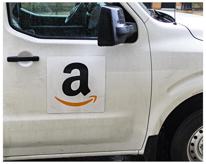 car with amazon logo on door