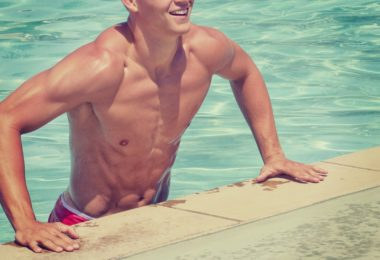 muscular man getting out of swimming pool
