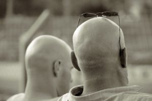 two bald men seen from behind
