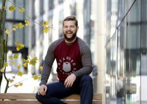 man sitting outside smiling