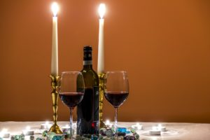 candles wine and glasses on romantic table