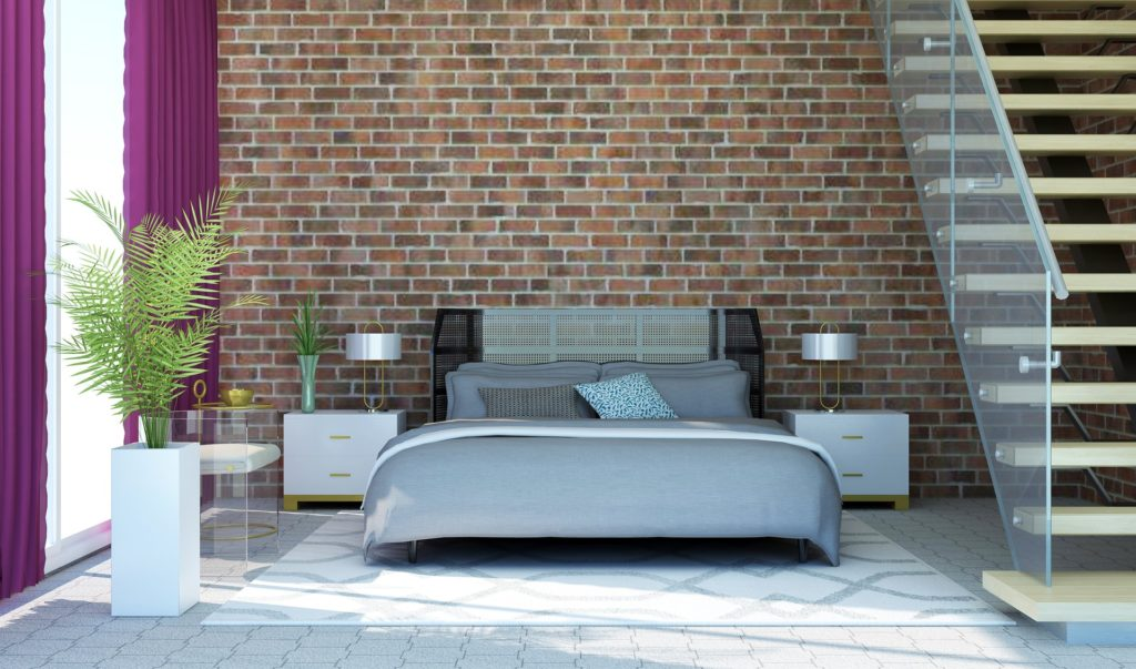 brick wall with bed and stairs in room