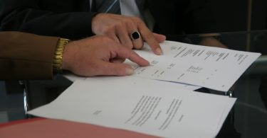 two people looking at contract