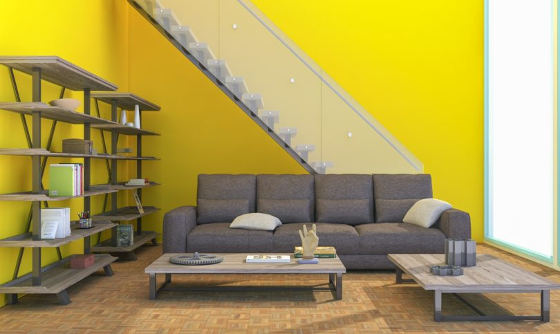 yellow wall with stairs and coach in front