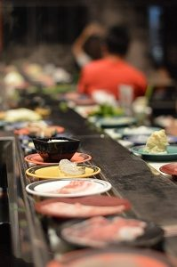 rotating conveyor belt with sushi