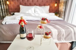 hotelroom with champagne and sweet treats