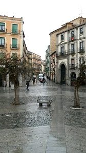 quiet square in barcelona with bench